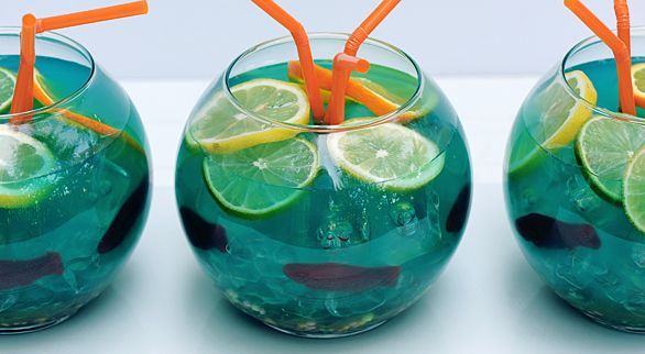 The cocktail is basically a slightly-altered Blue Hawaiian .for kids use pop..gravel is nerds candy, fish are gummy, use ice to hold fish to sides top with sliced fruit and add straws.food coloring for color of water.
