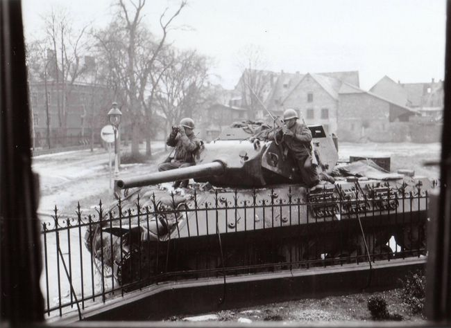 Members of Co. I, 313th Inf. Regt, 12th Armd Division on an M-10 in the streets of Haguenau, France. On alert against enemy patrols across the Model River. Feb 5, 1945. NARA #0012