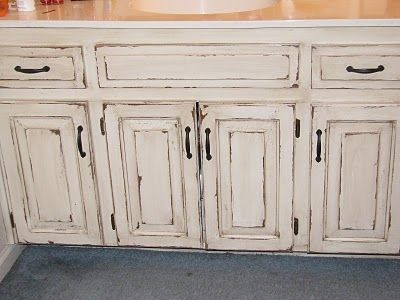 The Magic Brush, Inc.: Veryyyyyyyyyyry distressed cabinets I would LOVE to do this in the boys bathroom!!