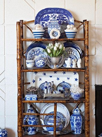 The blue and white pieces are arranged beautifully on the burnt bamboo etagere. I like the cornishware, the blue willow & the more formal ginger jars all mixed together. Great look!