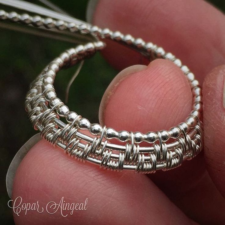 https://flic.kr/p/DTVZfH   Sitting here waiting for my daughter's school bus and playing with sterling silver bead wire.