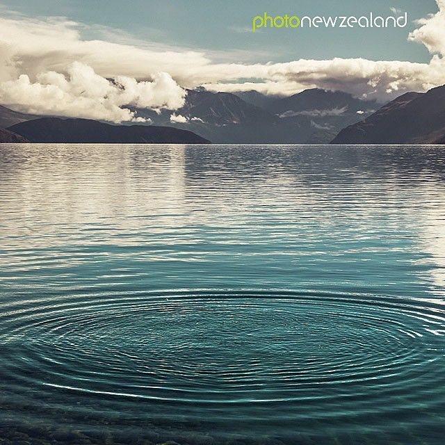 What's your technique to perform the perfect stone skim?  Share your pictures with us using the hashtag #photonewzealand  Image of the Day - Middle earth, ripple effect on water with mountains at Waterfall Creek, Lake Wanaka, New Zealand by Amanda Grace