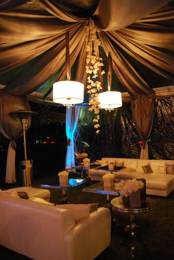 Wedding Lounge love the draping and flowers hanging