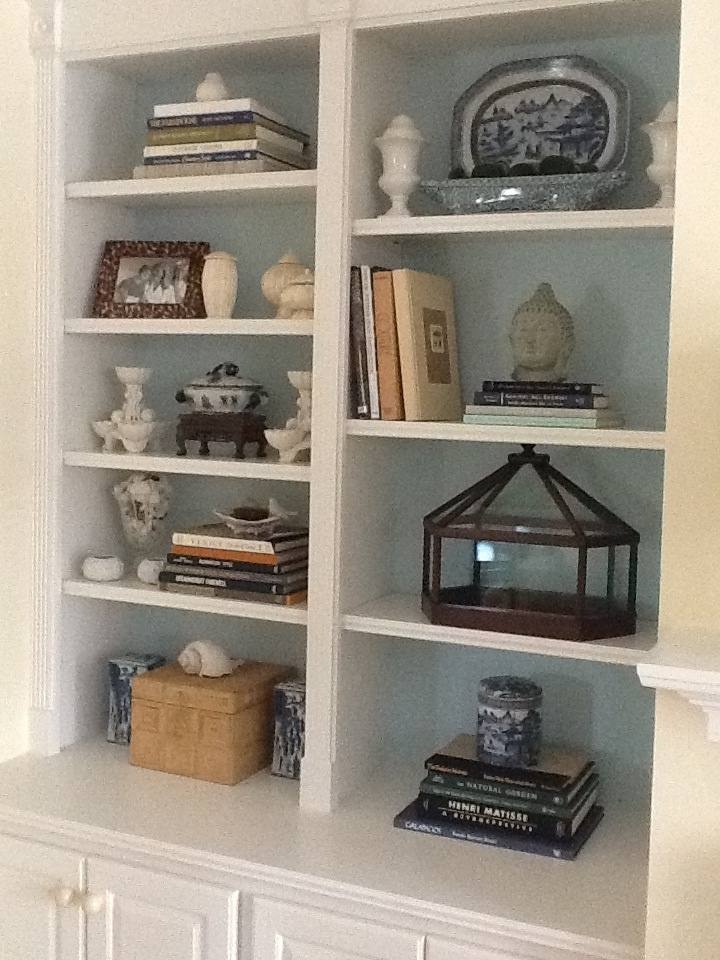 A Quick Easy Trick To Make The Items On Your Bookcase Pop Paint