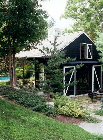 barn style pool house with a gorgeous cupola