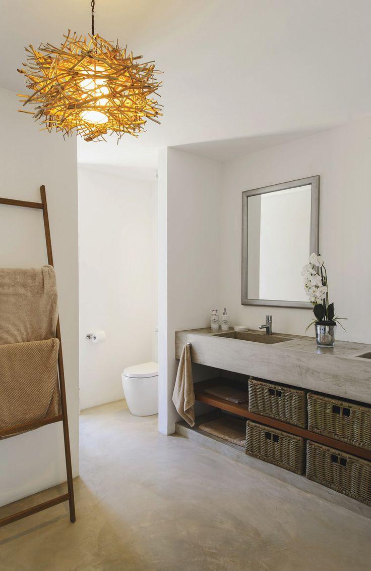 Le béton ciré fait son show dans cette salle de bains
