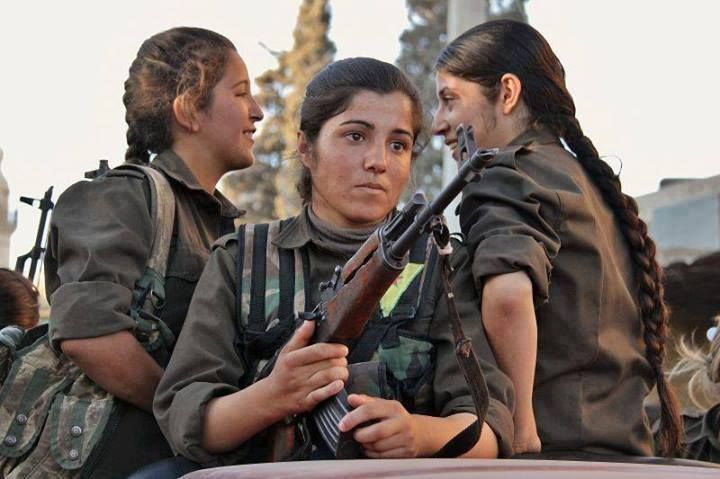 Meet the real, present-day Amazon Women. This photo is of 3 YPJ (The female chapter of the Kurdish People's Defense Unit) As I type this, they are fighting alongside their men to defend the town of Kobane from the ISIL (Islamic State). The YPJ is presently labelled a 'terrorist organization' by the US and NATO, so make sure your government approves before you favorite this photo. :-/