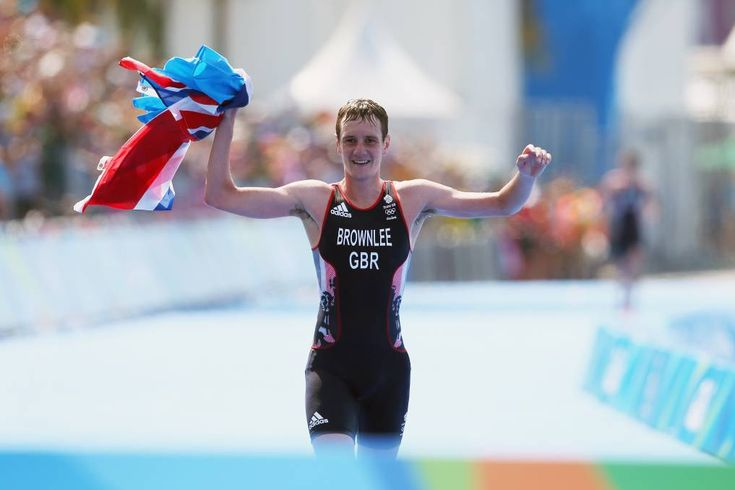 Alistair Brownlee of Great Britain crosses the finish line during the Men's…