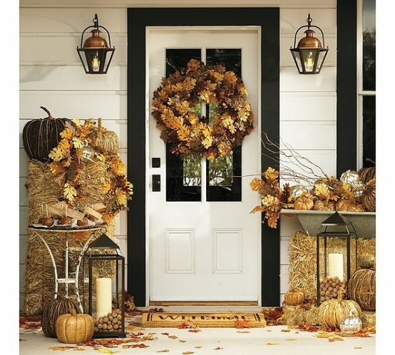 Use hay bales, pumpkins and lanterns for a welcoming autumn entryway