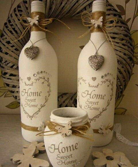 Handmade shabby chic wine bottles. Painted and decorated. Ideal tAble centre piece or gift ideas.