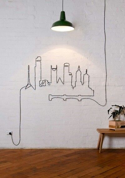 Philly Skylines Create your own | Home what a great idea for all those ugly hanging wire problem. ---- If I was a little bit craftier I would do this in the shape of the Philadelphia skyline!