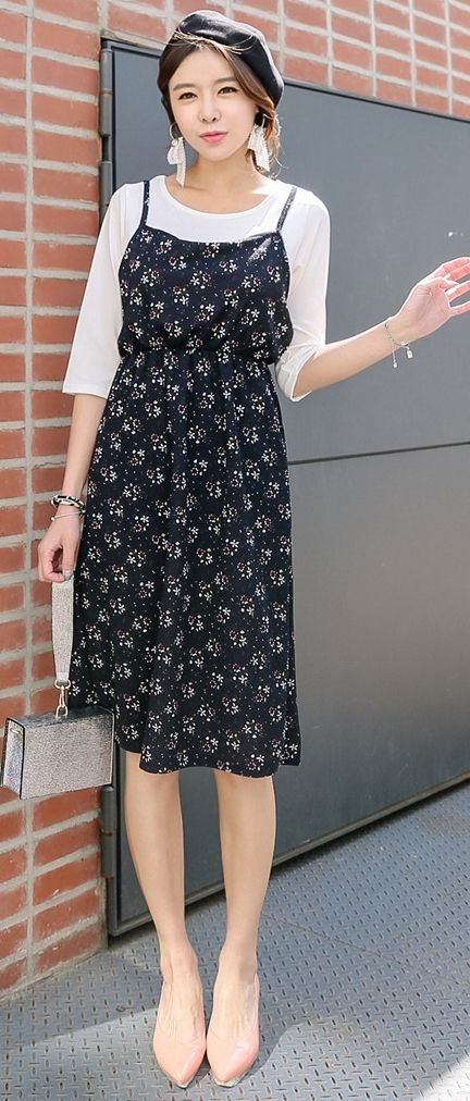 This pretty high waisted dark floral sundress looks lovely over an elbow length white shirt with a round neck. The spaghetti straps are still delicate enough for summer but work as a transitional piece anchored by the shirt beneath. Low nude pumps, small structured silver bag. Style Planet
