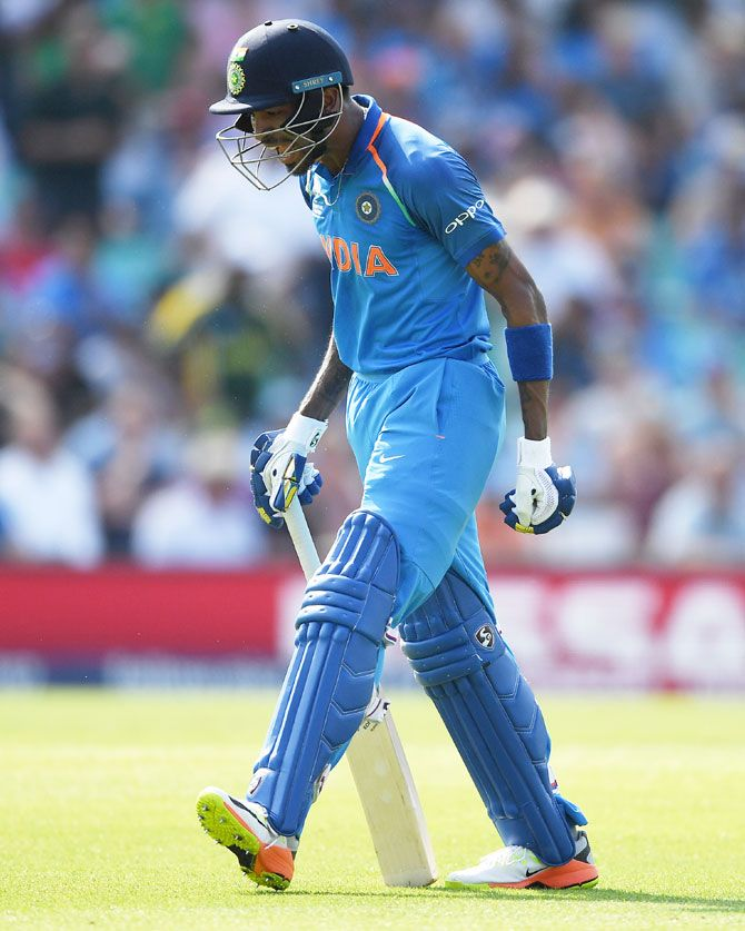 Hardik Pandya of India shows his frustration after being run out
