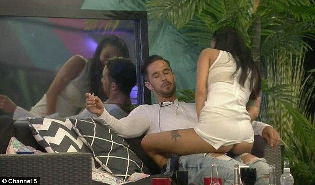 Cheeky: Evelyn Ellis and Alex Cannon's steamy antics came to light during Saturday night's episode of Big Brother as the house were shown a clip of the pair getting cosy in the smoking area
