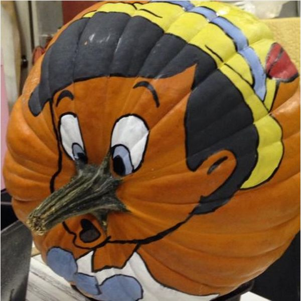 This witty painted pumpkin uses its stem as a convincing stand-in for…