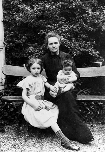 Marie Curie and her daughters Irène and Eve  sitting on a bench in the garden, 1905
