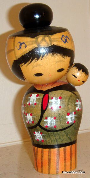"""Kokeshi and baby - """"Traditional"""" kokeshi dolls' shapes & patterns are particular to a certain area & are classified under eleven types. """"Creative"""" kokeshi allow the artist complete freedom in terms of shape, design and color and were developed after World War II (1945)."""