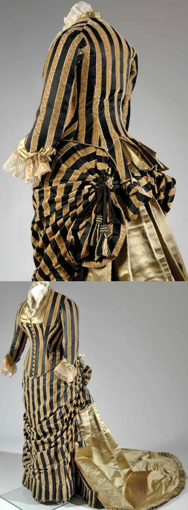 Evening dress, Worth, ca. 1884. Striped dark and light brown silk brocade and velvet. Long bodice with portrait neckline trimmed in brown green satin; off-white lace cuffs. Skirt with brown green satin back panel that extends into a train. Trimmed with dark and light brown silk fringe and tassels.