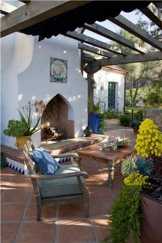 patio with pergola and fireplace outside a Spanish Mediterranean house // Great Gardens & Ideas //