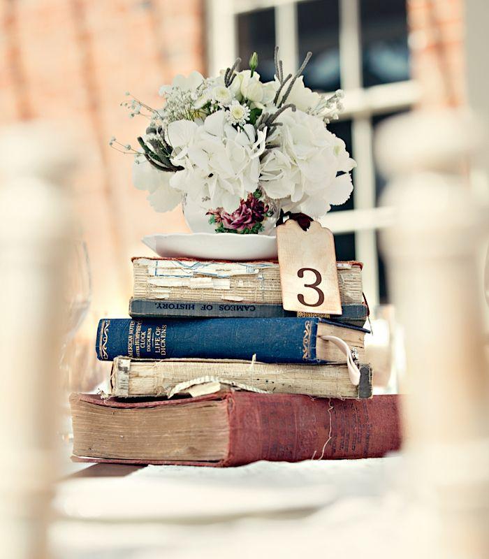 Book centrepiece. Dottie Photography #wedding #table #centrepiece