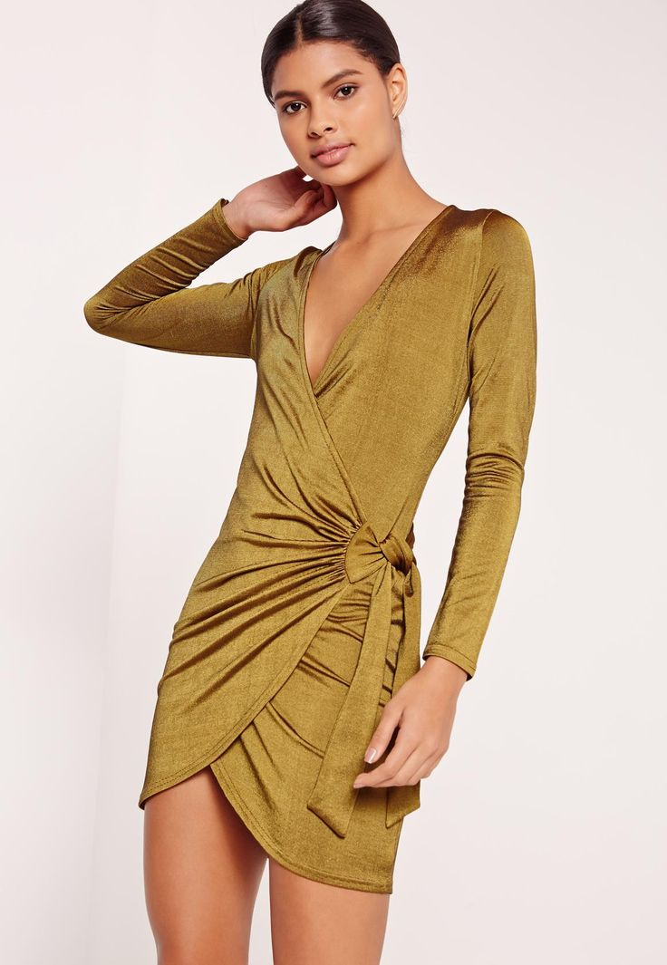 For a luxe effect, this wrap dress in a deep olive green and slink finish will take you through this weekend.