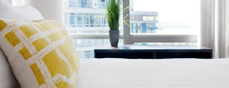 A bedroom with a view in one of our short term apartment rentals in vancouver bc #furnished_apartment_rentals #furnished_accommodations #furnished_suites