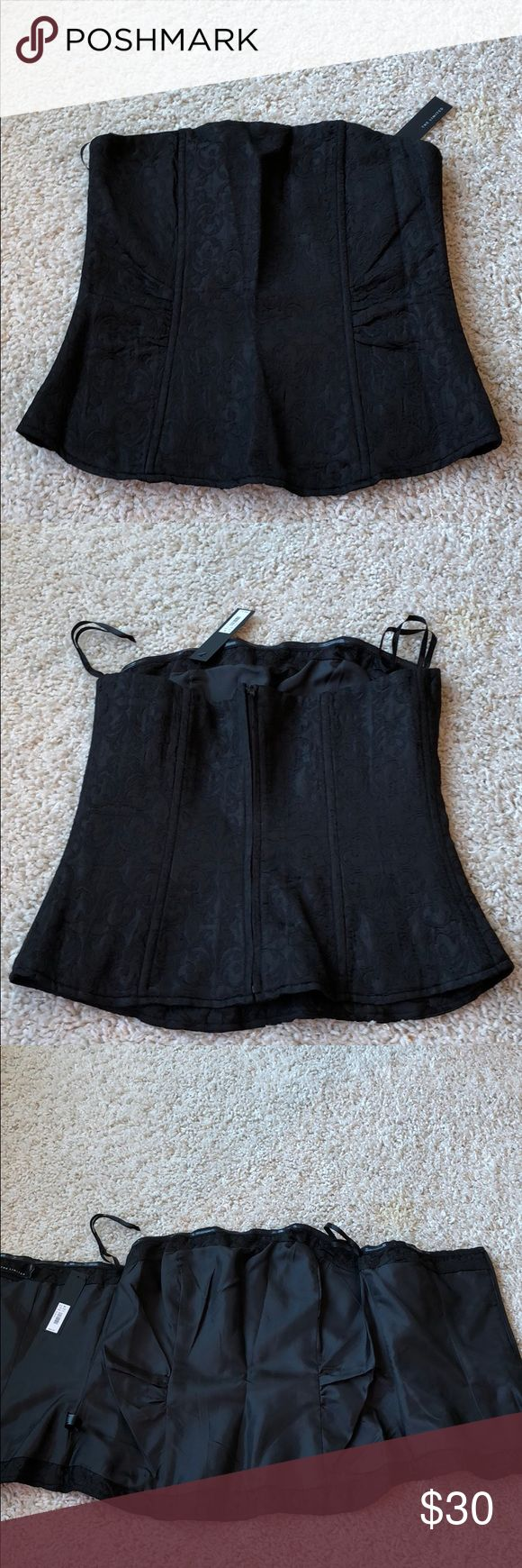 The Limited Black bustier top This BNWT black bustier top is perfect for an evening on the town. It has a zipper up the back and is a size medium. Their is a swirl pattern all over the top. The Limited Tops