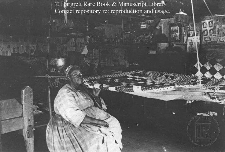 """""""Woman with Quilt"""" Robert E. Williams Photographic Collection: African-Americans in the Augusta, Ga. Vicinity (Richmond Co.), ca. 1872-1898 from the Hargrett Rare Book and Manuscript Library."""