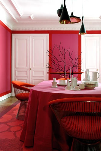 Pink dining room in designer Christophe d'Abboville home in Paris