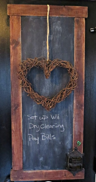 Pantry door chalkboard...love the grapevine heart for valentines day!  Check out the chalkholder...