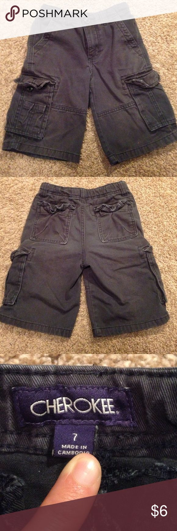 Boys navy blue cargo shorts. Cherokee brand navy blue cargo shorts. There are a few light spots (no bigger than a pen tip) on the front and back. Maybe small bleach marks? I can't quite tell but they are not very noticeable! Cherokee Bottoms Shorts