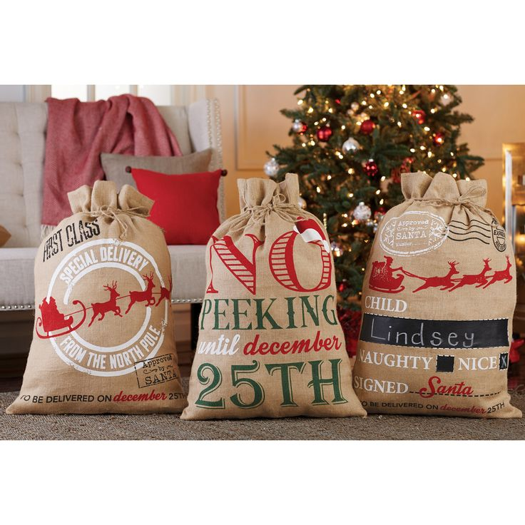 """Approved by Santa"" and ""Reindeer Express"" oversized reusable drawstring burlap sacks from Mud Pie feature Santa and reindeer appliques with pom-pom nose accents. Arrives with reversible vinyl burlap tag for personalization. Bags wrap one large giant gift or a number of smaller ones. It's never to early to start thinking about Christmas! Size 31"" x 22"".  From Mud Pie. Usually ships next day."