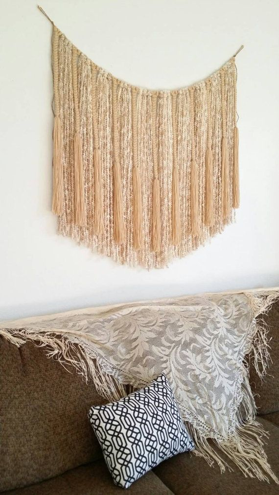 This is a large yarn wall hanging or banner that would make a great statement piece above a bed or sofa. I have braided/knotted acrylic yarns to