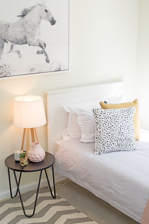 Kids bedroom, teen bedroom, sunny renovated small apartment, white timber single bed frame, horse artwork, mustard and pink, spotted cushion