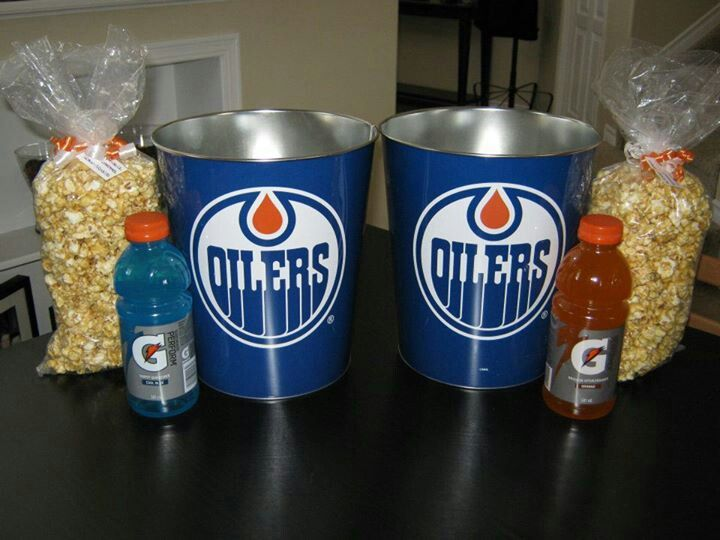 Boy party grab bag idea. Go to the dollar store and purchase hockey garbage cans. Fill with homemade caramelized popcorn and a bottle of gatorade.