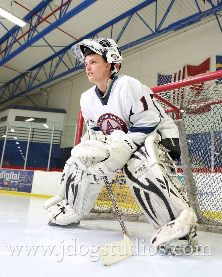 Hockey senior picture: Thanks Jdog Studios for laying on the ice to grab this shot of my son!