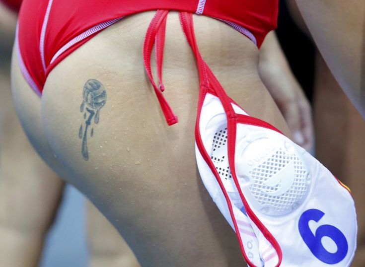 Tattoo is seen on Spain's Andrea Blas Martinez during their women's water polo quarterfinal round