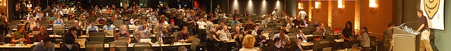 A quick and dirty panorama of the audience at Gnomedex with all their laptops before Kris Krug's opening presentation, in the tradition of my popular 2006 and 2005 versions, and Northern Voice 2008.    Perhaps the world's highest density of laptops out