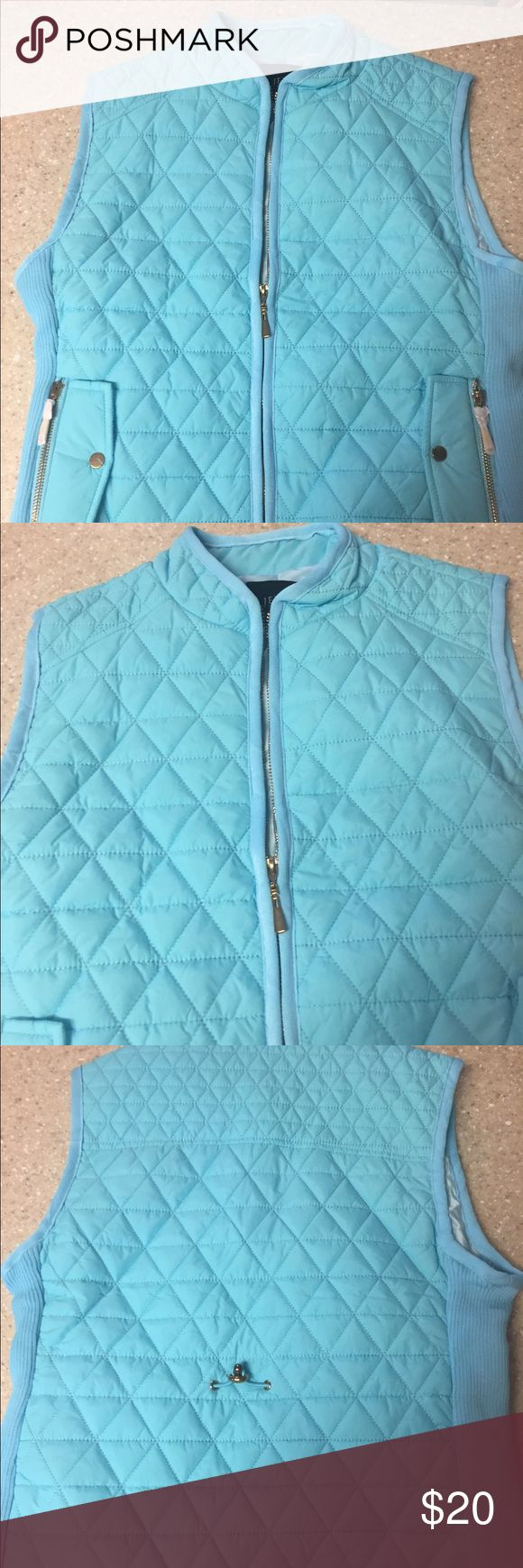 NWOT light blue vest Quilted look but nice and thin comfy Super stylish. Bought new from boutique and never wore Jackets & Coats Vests
