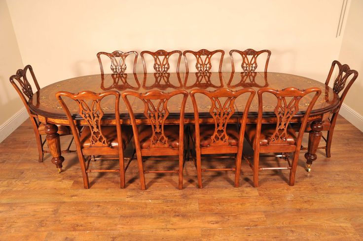 http://canonburyantiques.com/s/tables/victorian-dining-tables/1/  Antique Victorian dining set - with matching set of Chippendale chairs. Exquisite.
