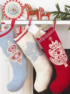 Sew embroidered Christmas stockings