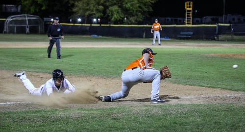 Winter Park's Hunter Lee (3) steals third base with a slide as Ovideo's Mitch Reeves (3) waits for the ball during third inning action of a boys high school baseball game against Oviedo in Winter Park, Fla.