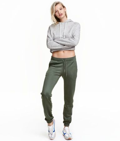 Black. Joggers in sweatshirt fabric with an elasticized drawstring waistband, side pockets, and skinny legs with elasticized hems.