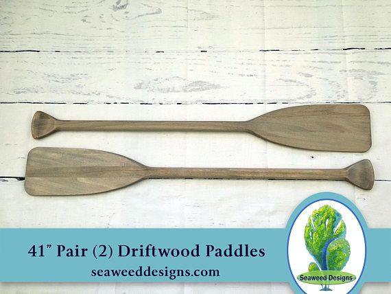 Dont want to stain your own oar or paddle? I can help. Offered in this listing is for a pair of two (2) 41 paddle stained with homemade driftwood stain. (Please note starfish, sailboat and fish are props and not included). Great for nautical wedding guest book, nautical preppy rooms,