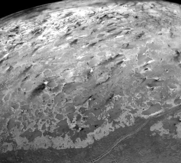 Dark streaks on Triton (moon of Neptune) formed by deposits from ice or cryovolcanos. Credit: NASA