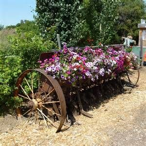 landscaping with antique farm equipment - Bing Images