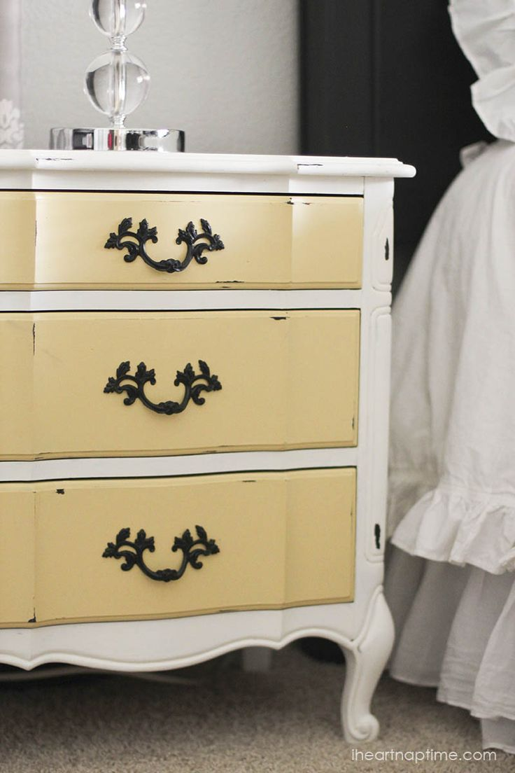 The Yellow Drawers on this dresser are so pretty! Yellow & White Painted Dresser #YellowDresser #PaintedFurniture