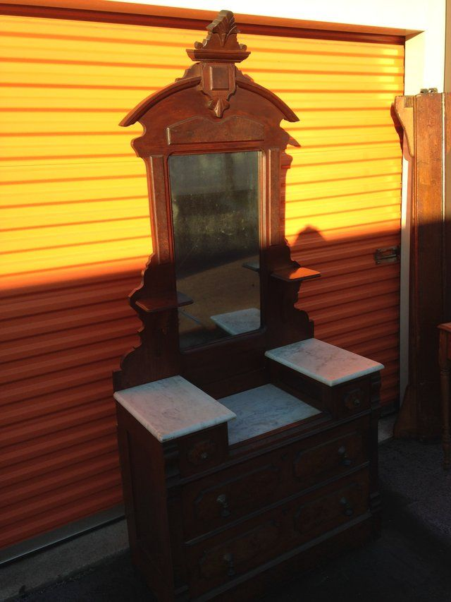 """ALL Original Walnut Victorian Vanity. 3 Marble tops,  small drawer's over 2 large drawer's.. 2 Candle Holder's, Tear drop pulls and porcelain wheel's.  <br>83""""H (Mirror 52""""H, Vanity 31""""H) X 37""""W x 18""""D. Very Clean ! <br>Reduced from $600. <br>Will Consider Trading for Gold Jewelry  / Silver Coins / Firearms"""
