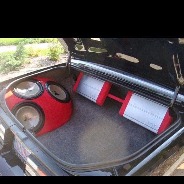 JL Audio subwoofers on the side fiberglass red custom box regal