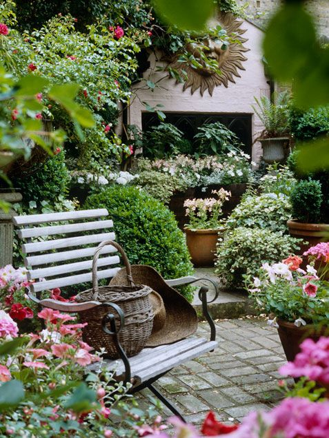 Restful Retreat!  Try filling a small patio with several pots of pretty flowers to create your own personal secret garden....Love this!!